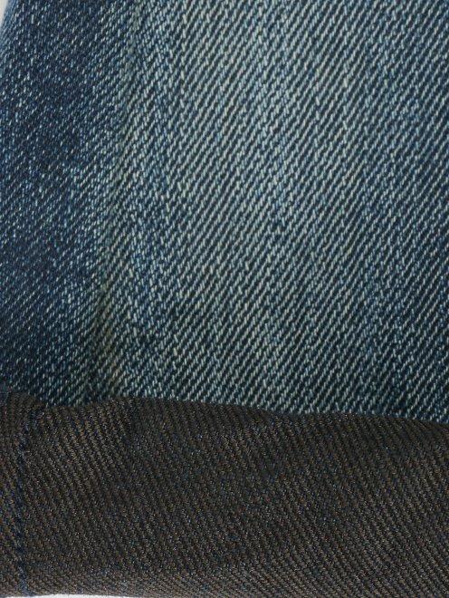 Джинсы-клеш с декором на кармане - Деталь2