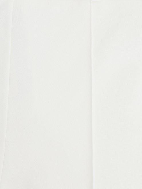 Укороченные брюки с контрастными лампасами - Деталь1