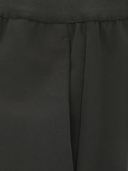 Брюки на резинке с карманами - Деталь