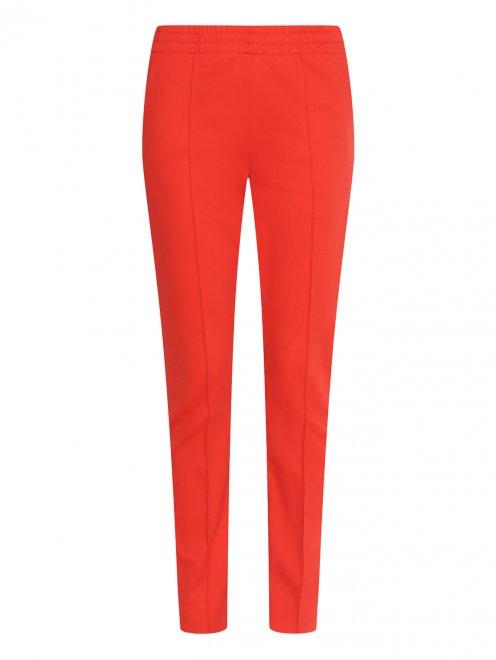 Узкие брюки на резинке с боковыми карманами - Общий вид